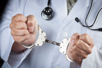 Physician in Handcuffs