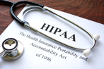 HIPAA documents with stethescope resting on top